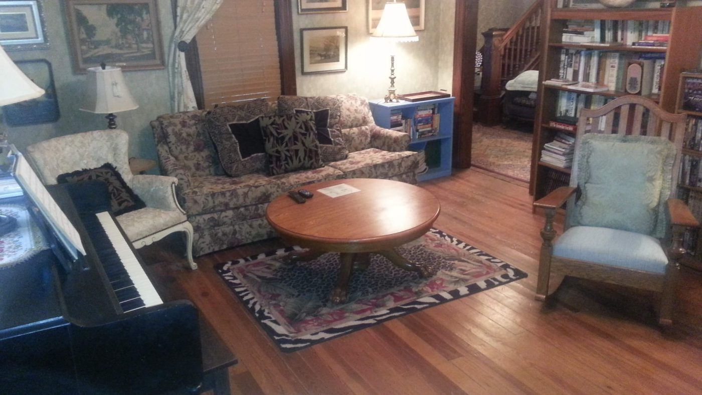 The front library has a comfortable queen size sleeper sofa and piano.
