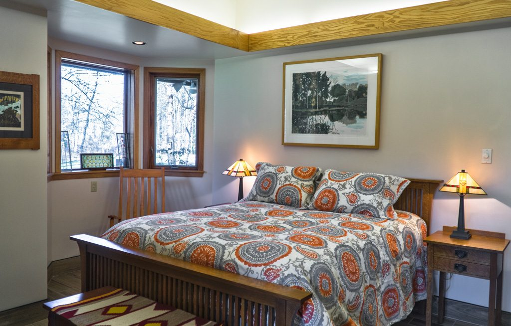 Enjoy the Master Bedroom with private stone porch and attached bath!