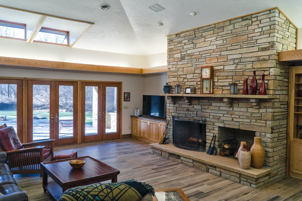 Spacious Great Room with wood fireplace and vaulted ceiling!