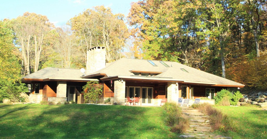 This country estate sits on nearly 4 streamside acres!
