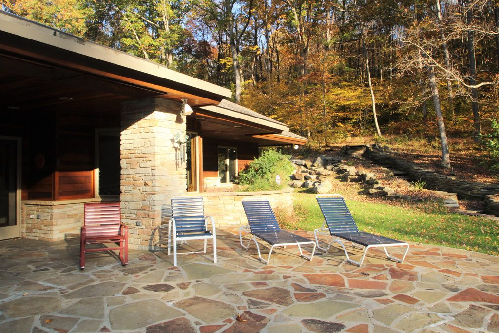 Enjoy the Sun on this oversized stone patio!