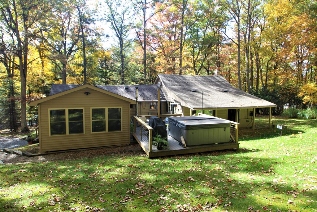 Beautiful in any season!  View of Private Decks including Hot Tub/Spa, Grill and Picnic Area.