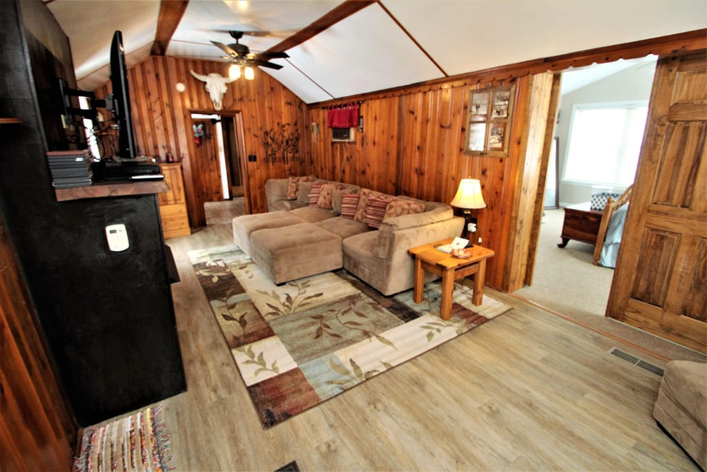 View of Living Room and access to large addition bedroom via barn doors!