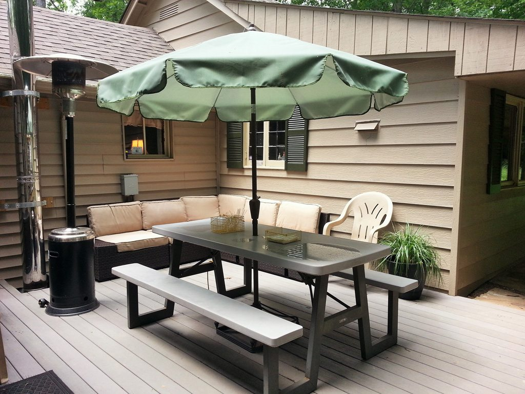 Patio Umbrella, heater and sofa make for good eats and comfortable nights!