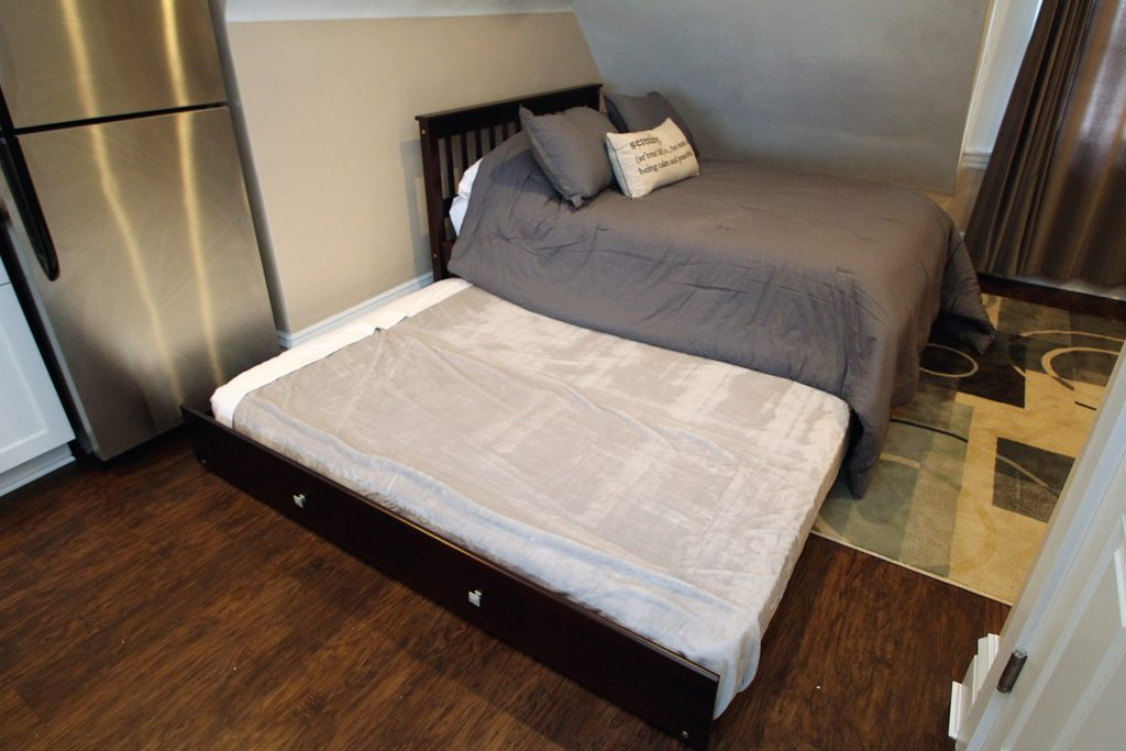 Queen bed--doubles as a trundle!