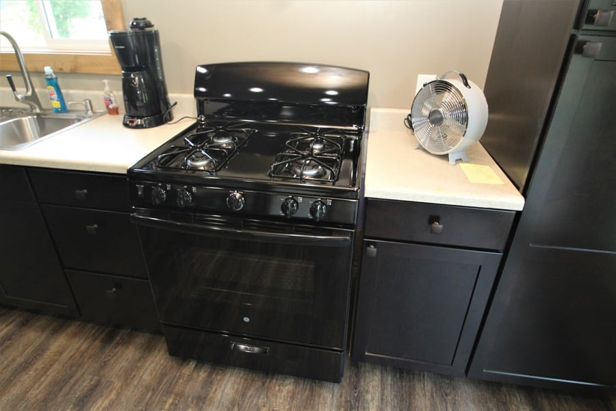 Full size Gas (propane) stove, oven and broiler.