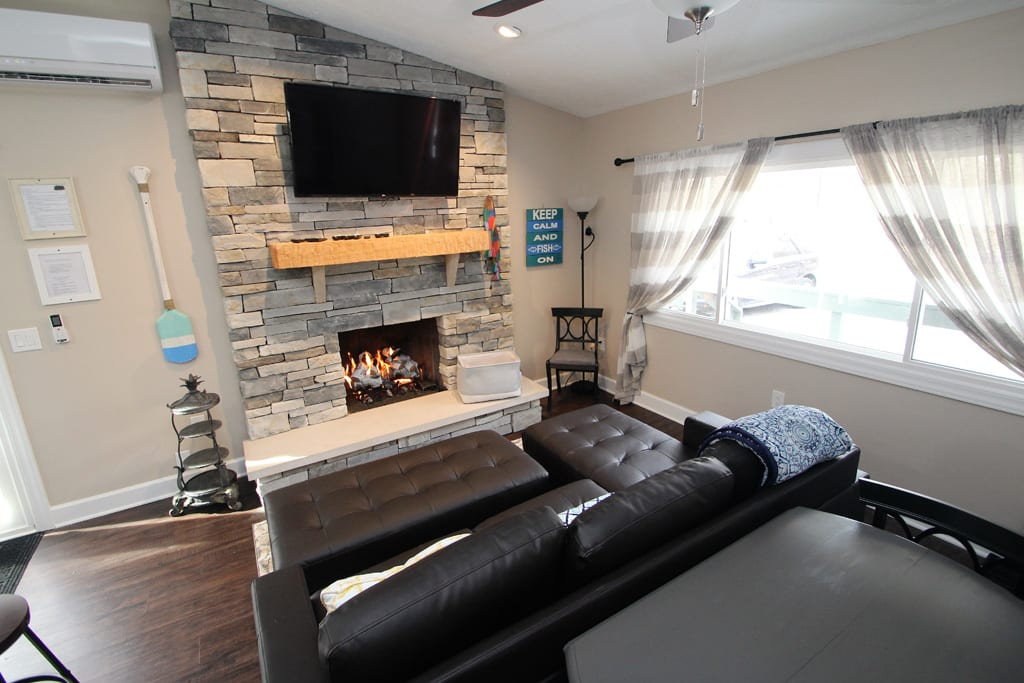 Big screen TV (cable), hand hewn mantle and gas fireplace!