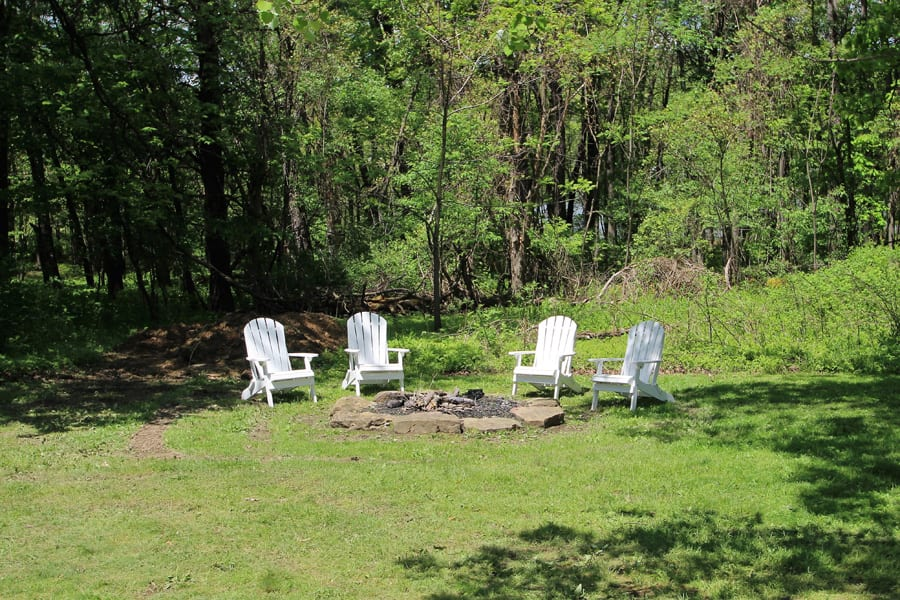 Rustic firepit with adirondack chairs