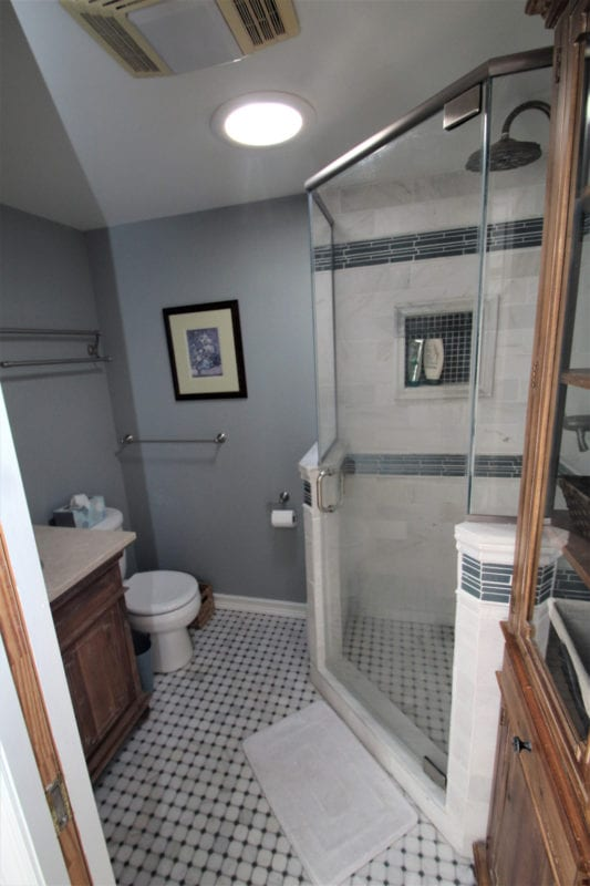 Large bathroom with stand up shower enclosure