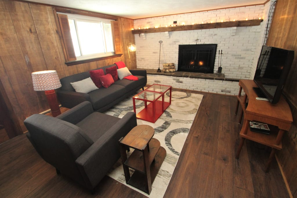 Downstairs living room with gas fireplace and HDTV!