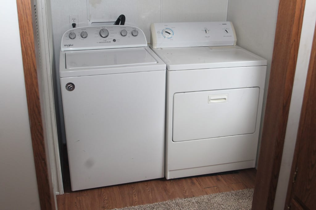 Yes, there is laundry! Located right off the kitchen!