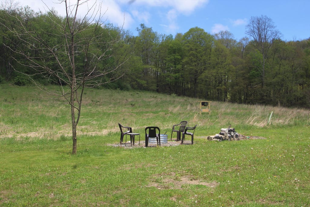 Rustic Fire pit sits about 20 yards from home.