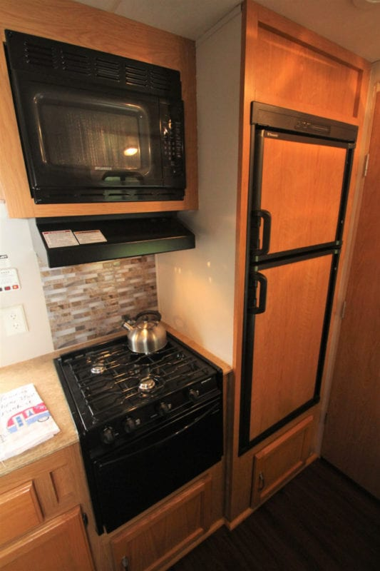 Kitchen includes stove top, microwave and refrigerator!