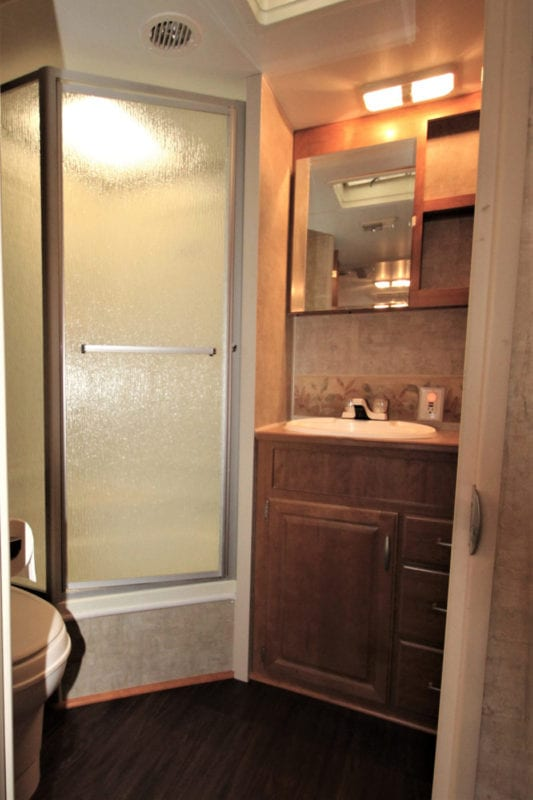 Large bathroom with stand up shower with sky light!