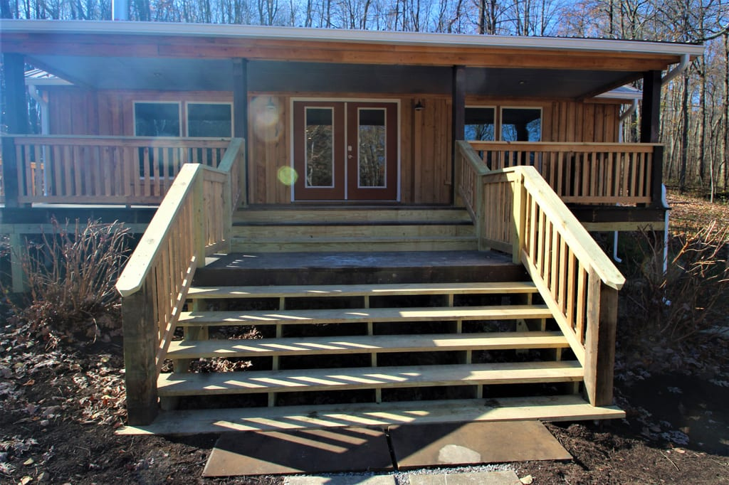 Extra wide stairs lead up to the wrap around deck.
