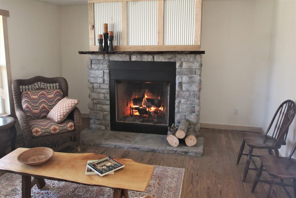 Kick back on the couch and enjoy the view of the fireplace. Firewood is BYO.