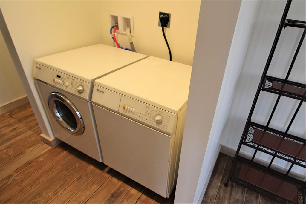 Plenty of space on top of the washer and dryer to fold clothes.
