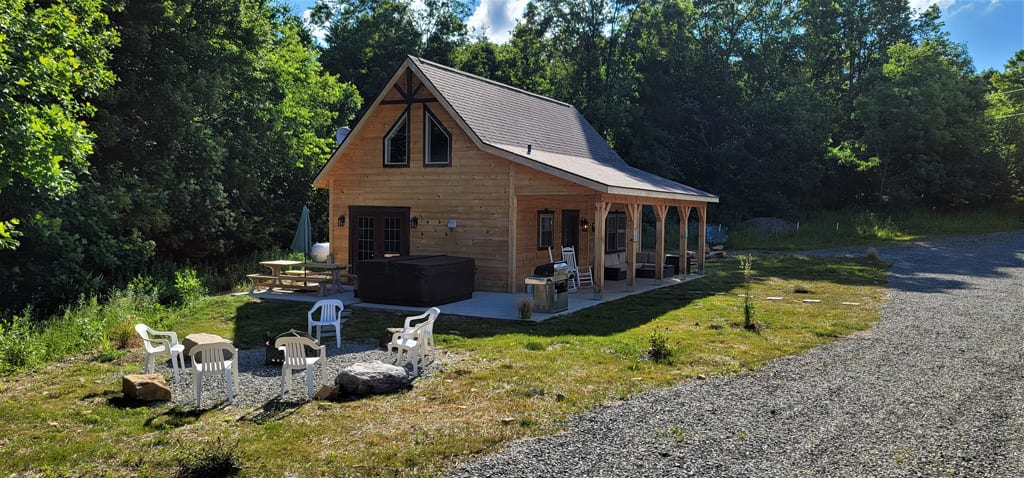 Hot Tub, firepit and patio porch make this cabin's outdoor spaces grand