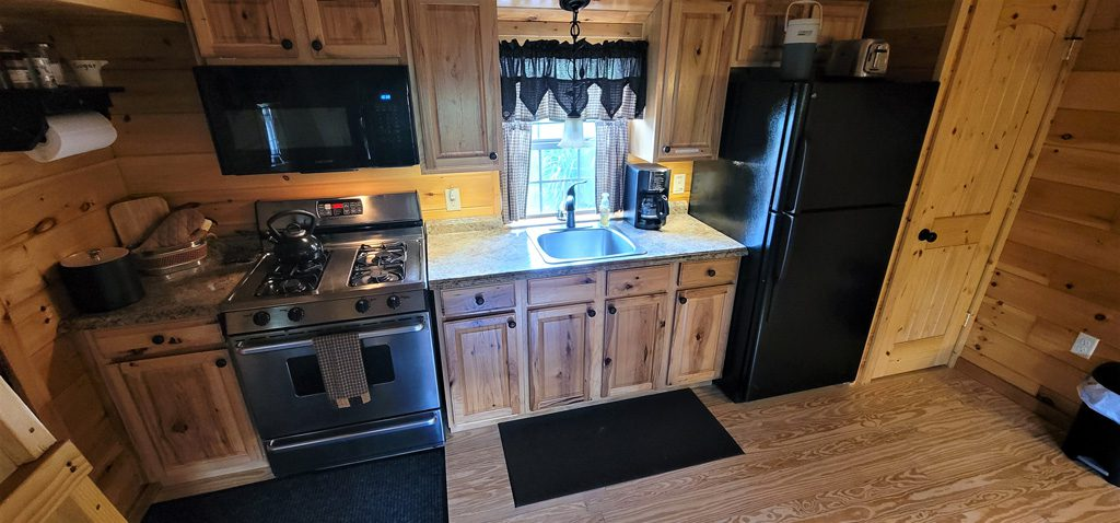 Microwave, Gas Stove/Oven, Single Bowl Sink, Refrig, kettle, Reg Coffee Maker