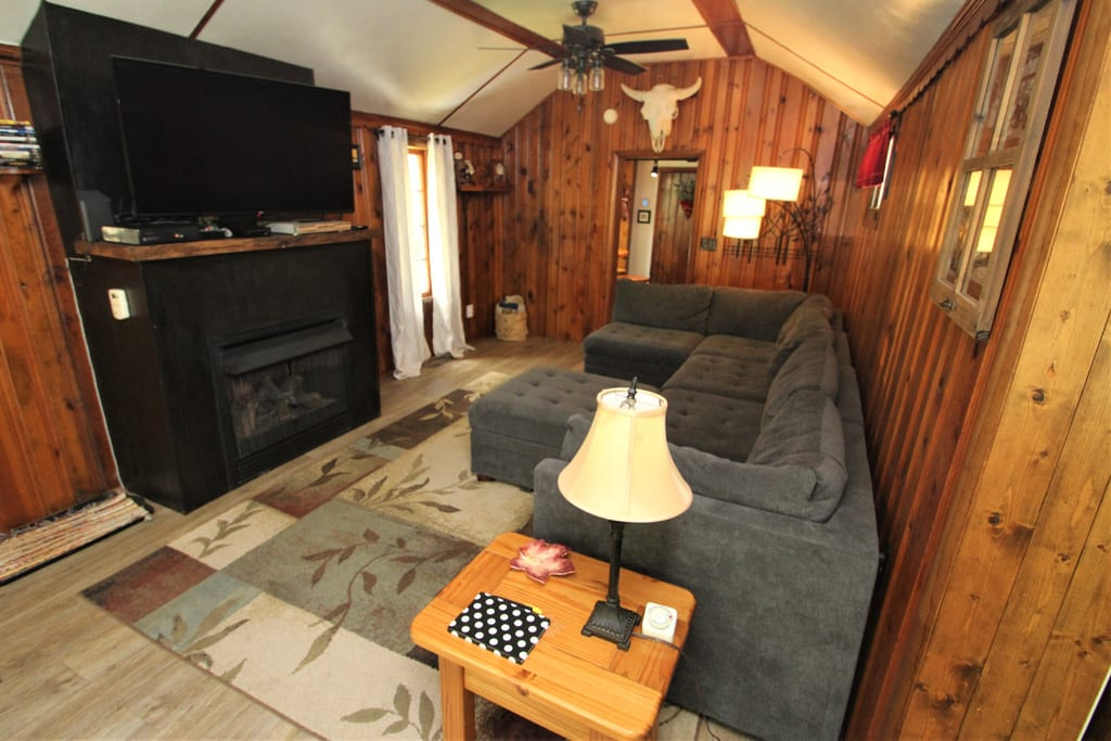 The living room includes a gas fireplace, 50