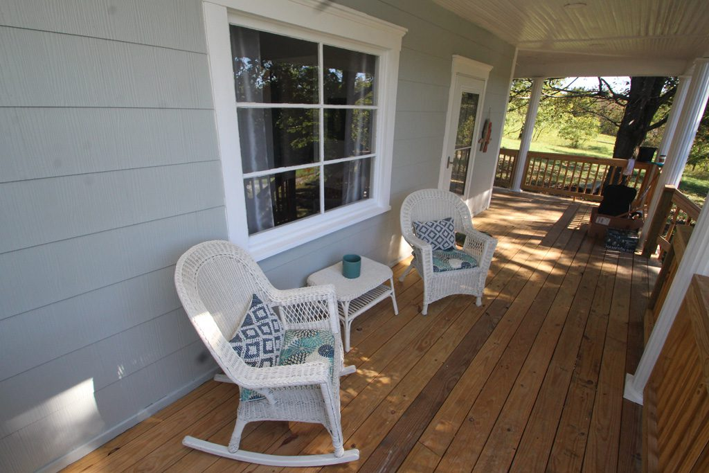 Enjoy your morning coffee or evening beverage on the covered porch.