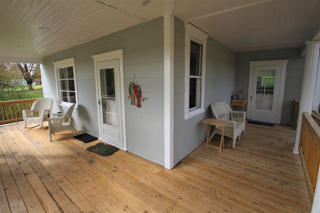 Lots of seating on the expansive wraparound covered deck/porch.